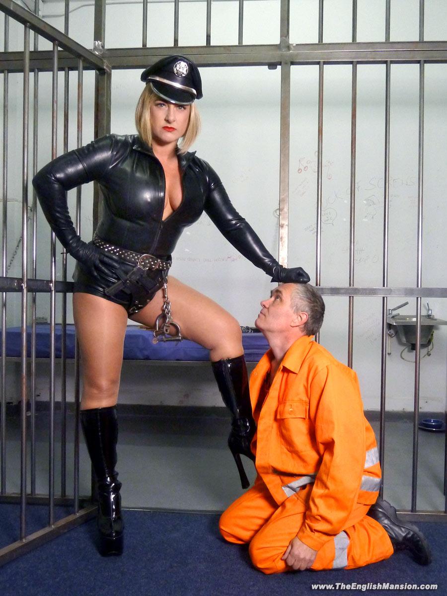 Cruel-rubber-femdom-prison-guard.jpg