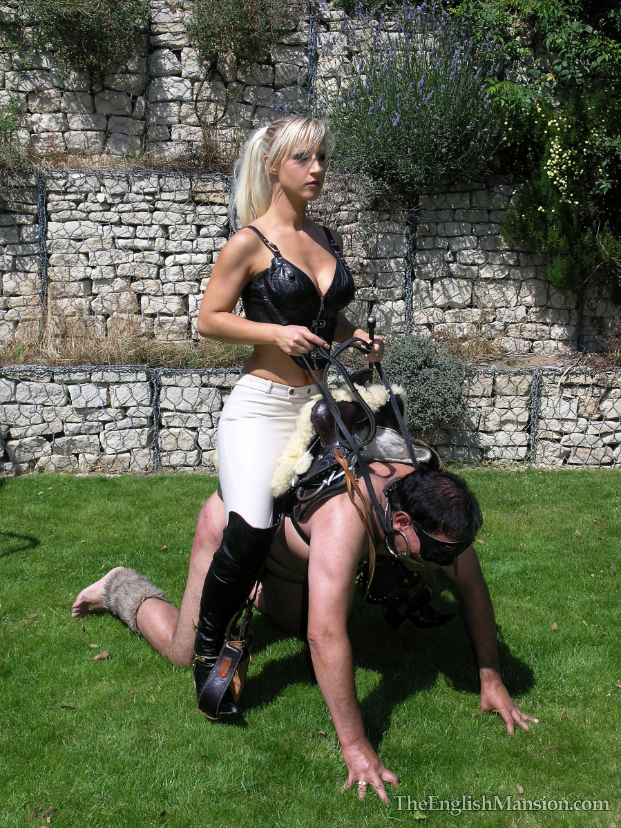 Mistresses and the submissive slave boy 4